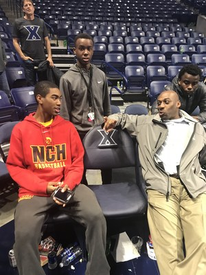 NCH basketball players watching a Xavier game