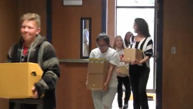 Students Carrying in Donation
