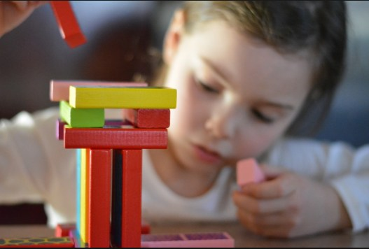 Young girl playing with blocks picture