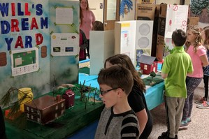 students look at the exhibits