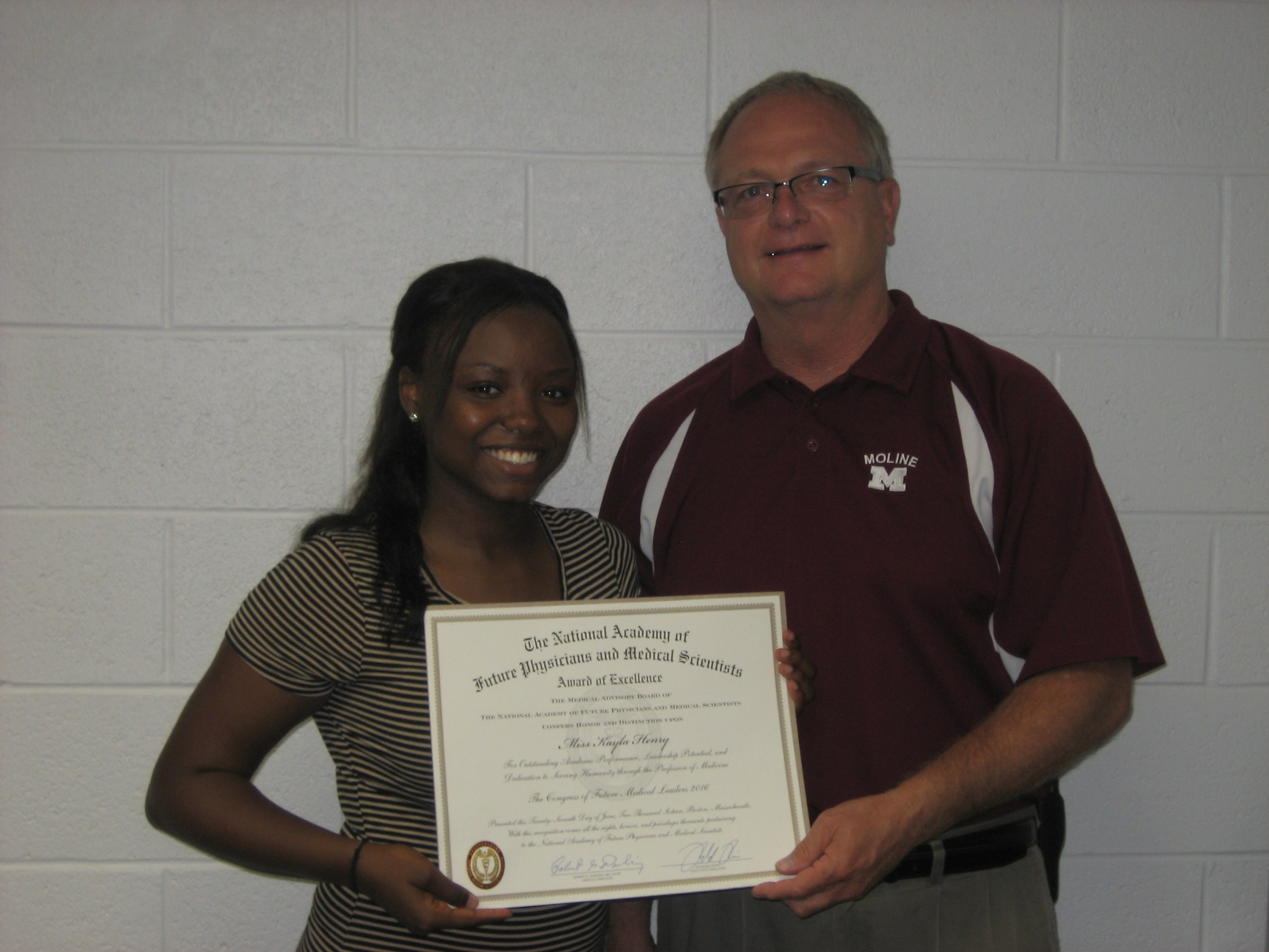 Photo of Student Kayla Henry with Principal Dan McGuire.