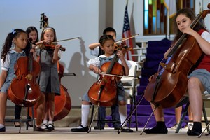 Students playing in the orchestra