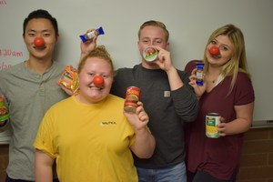 Teenagers wearing foam red noses