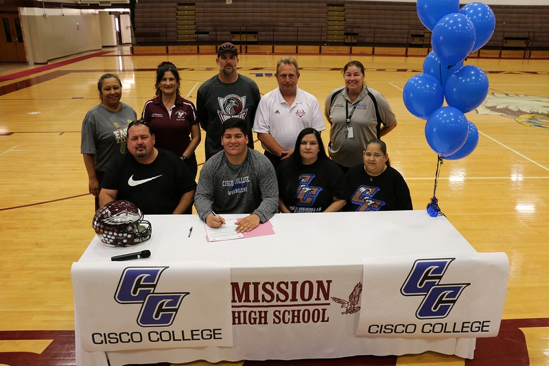 Group picture of Javi about to sign his letter of intent