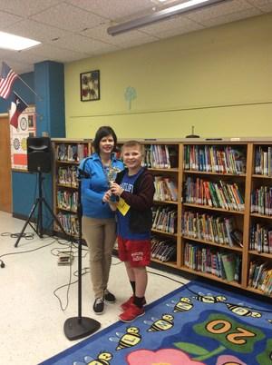 Winner Chris De Leon posing with Mrs. E. Rodriguez.