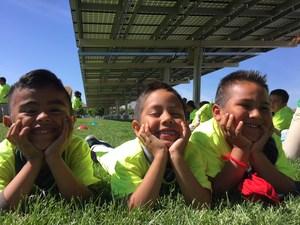 three smiling spectators