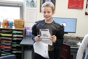 A student dressed as the word opaque.