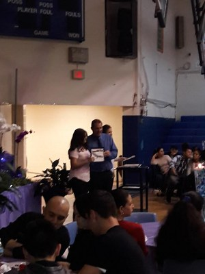 Mr. Cirone presenting award to unknown student