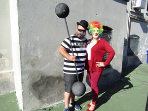 Strong Man and clown dance at parade