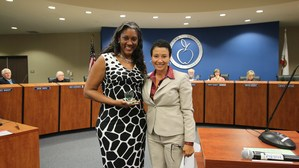 Fifth grade teacher, Stephanie McCravey-Cooper and Deputy Superintendent Dr. LaFaye Platter at the Governing Board meeting.