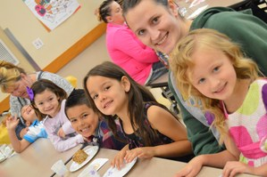 Kindergarteners and their moms at muffins for moms