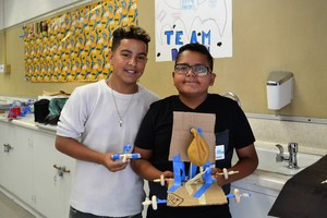 Baldwin Park Unified seventh-graders Christian Mema and Nathan Alfonso proudly display their winning balloon-powered car and popsicle-stick catapult constructed for THINK Together's science, technology, engineering and mathematics (STEM) projects. THINK Together's month-long summer enrichment program combines the fun of summer through hands-on activities and field trips with learning opportunities to prevent summer learning loss.