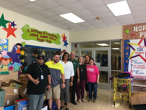hopkins elementary staff members accept donations from hurricane harvey relief
