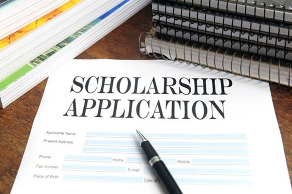 A picture of a piece of paper with the words scholarship application on it.