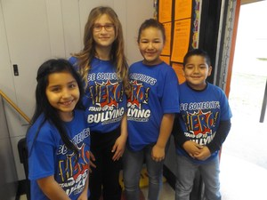 Doyle students wearing HERO shirts