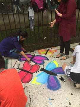 Students drawing butterflies