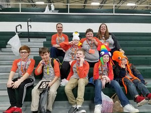 One of the two Page teams shows off their first place medals at the regional OM contest.