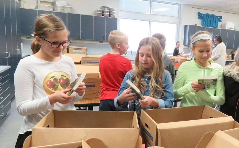 Page students pick out books for the Battle of the Book competition taking place now through March.