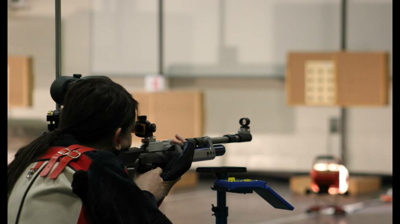 Student practicing shooting targets with air rifle
