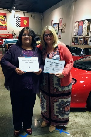 Mirna Colocho and Stacey Kraack display their awards