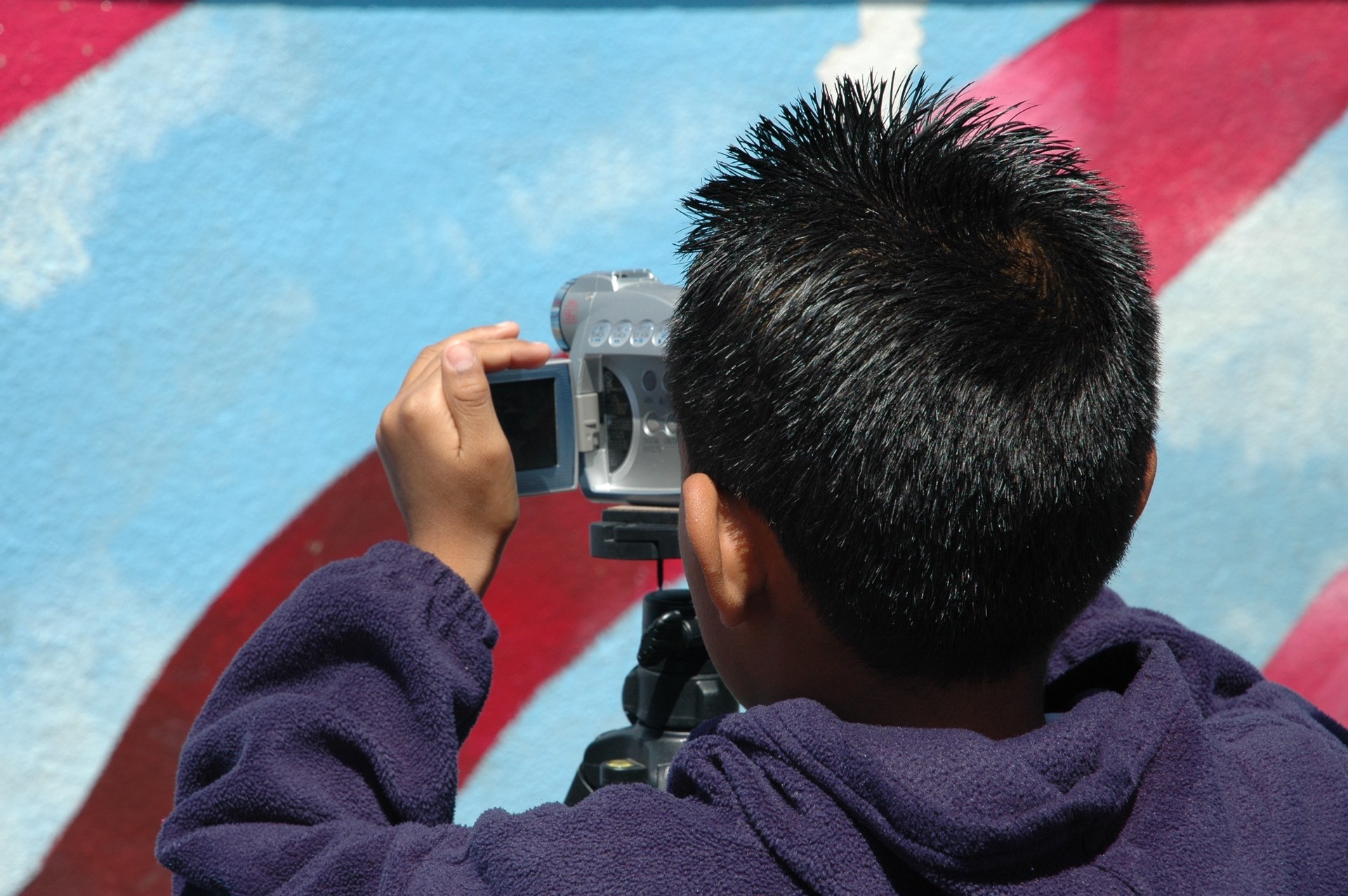 Student with video camera.