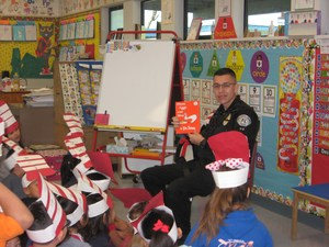 "Baldwin Park Unified police dispatcher Issac Salazar reads ""Counting on Frank"" to a group of sixth-graders at Santa Fe Elementary for the school's Read Across America celebration."