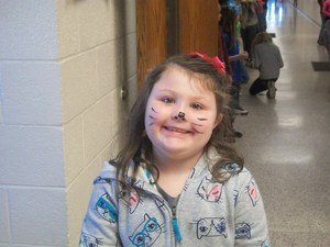 Student dressed as a cat for Dr. Seuss' birthday.