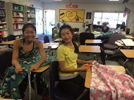 Photo of students enjoying the craft of creating no-sew blankets