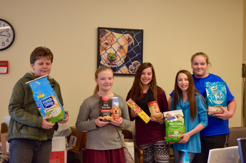 Students deliver donated animal car supplies to the Isle of Wight County Animal Shelter