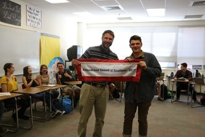 Principal Jon Hoerl presents banner to Student Council.