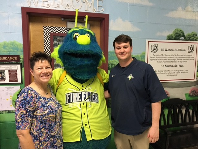 Fireflies mascot, Mason, encourages students to reach their reading goals.
