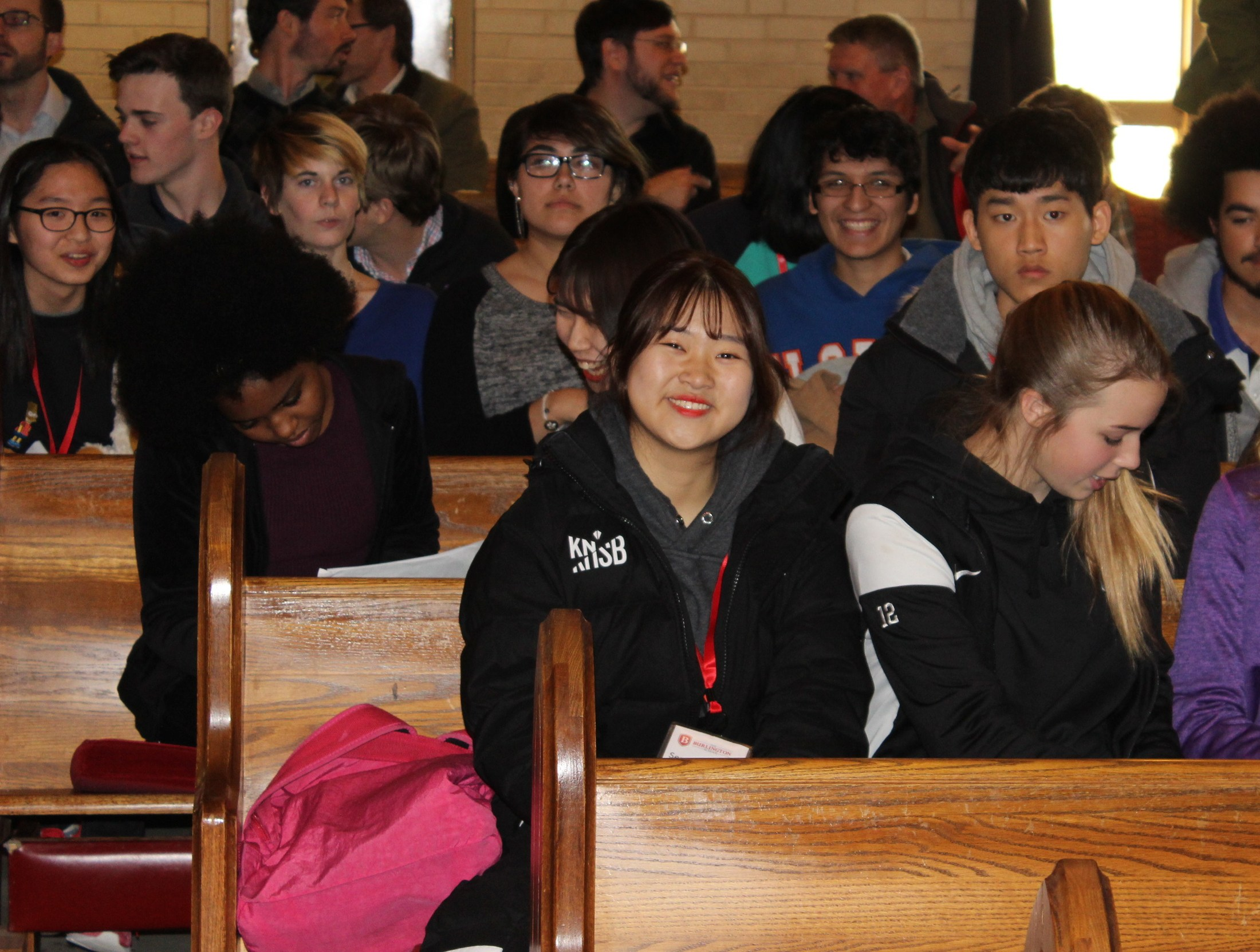 South Korean Student sitting in morning meeting.