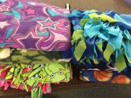 Photo of blankets created by students to be donated to children with long-term illnesses