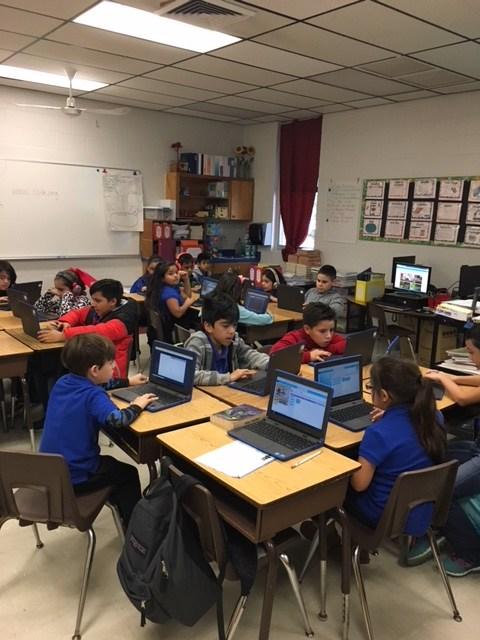 classroom of students using Chromebooks