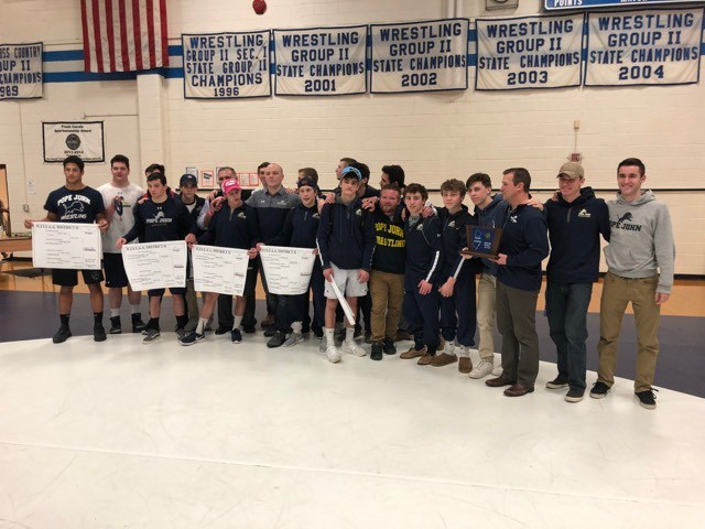 PJ wrestling team photo from District 2