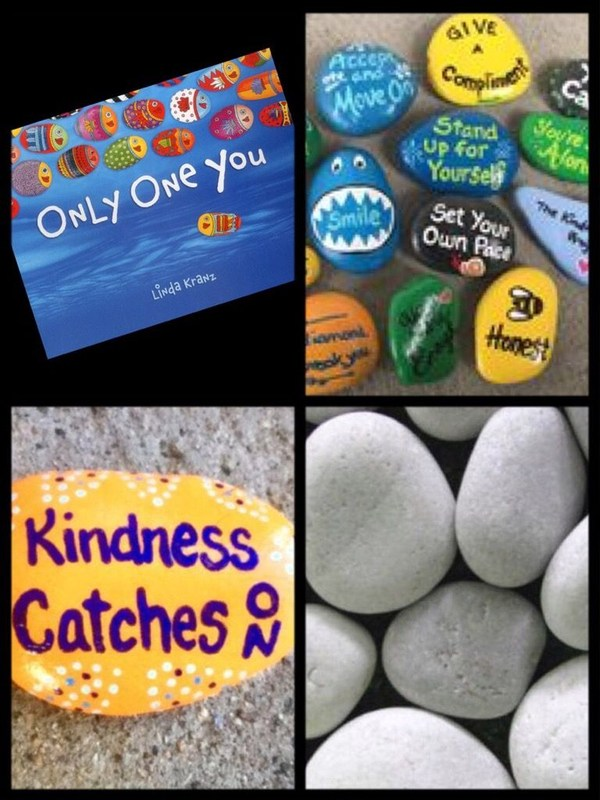 painted rocks with kind messages in a rock garden