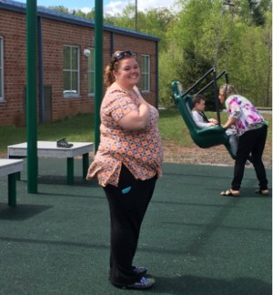 Mrs. Bethany Eggett stands in the new playground