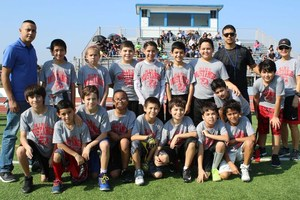 Group picture football players and coaches.