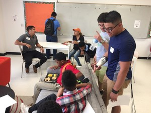 Project MALES Mentors working with Manor Middle School students.