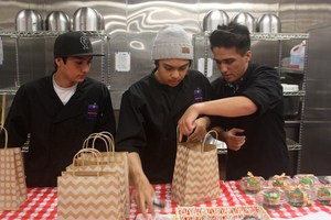 students pack lunches for staff member