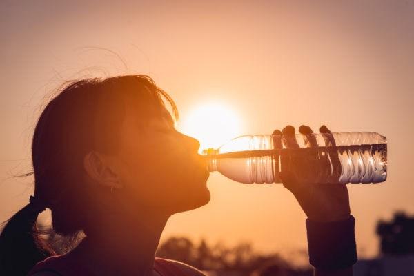 Girl drinking water in heat