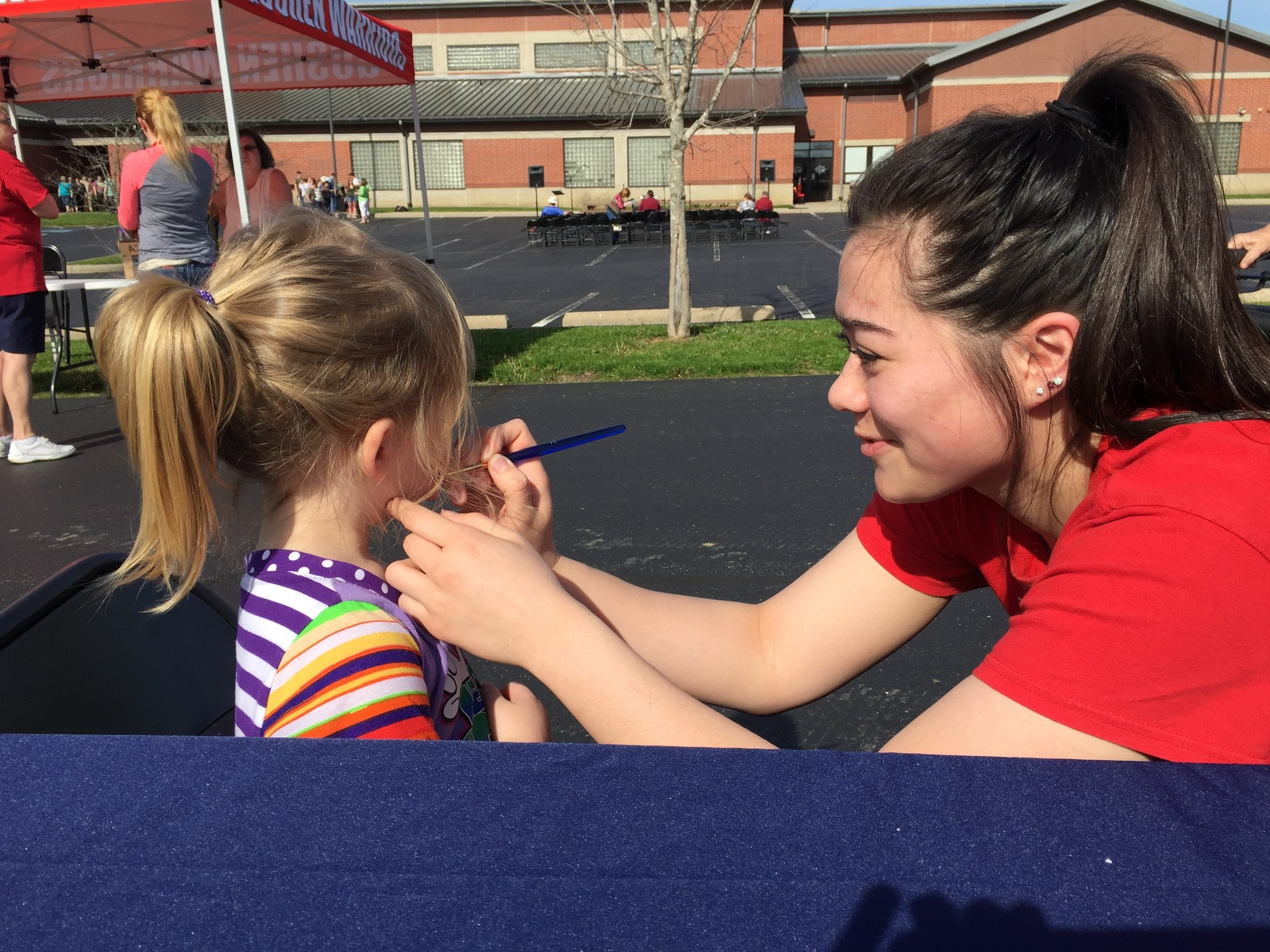 Katie face painting at Earth Day 2016