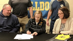 Jaidin Clemens signs her letter of intent to wrestle at Adrian College.