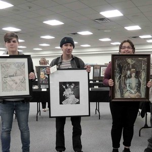 Amanda Watson, Josh Duran, and Melanie Jansen holding their art projects.