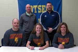 Gracie Verhage signs her letter of intent to play soccer at Ferris with her mom, dad, coach and athletic dir.