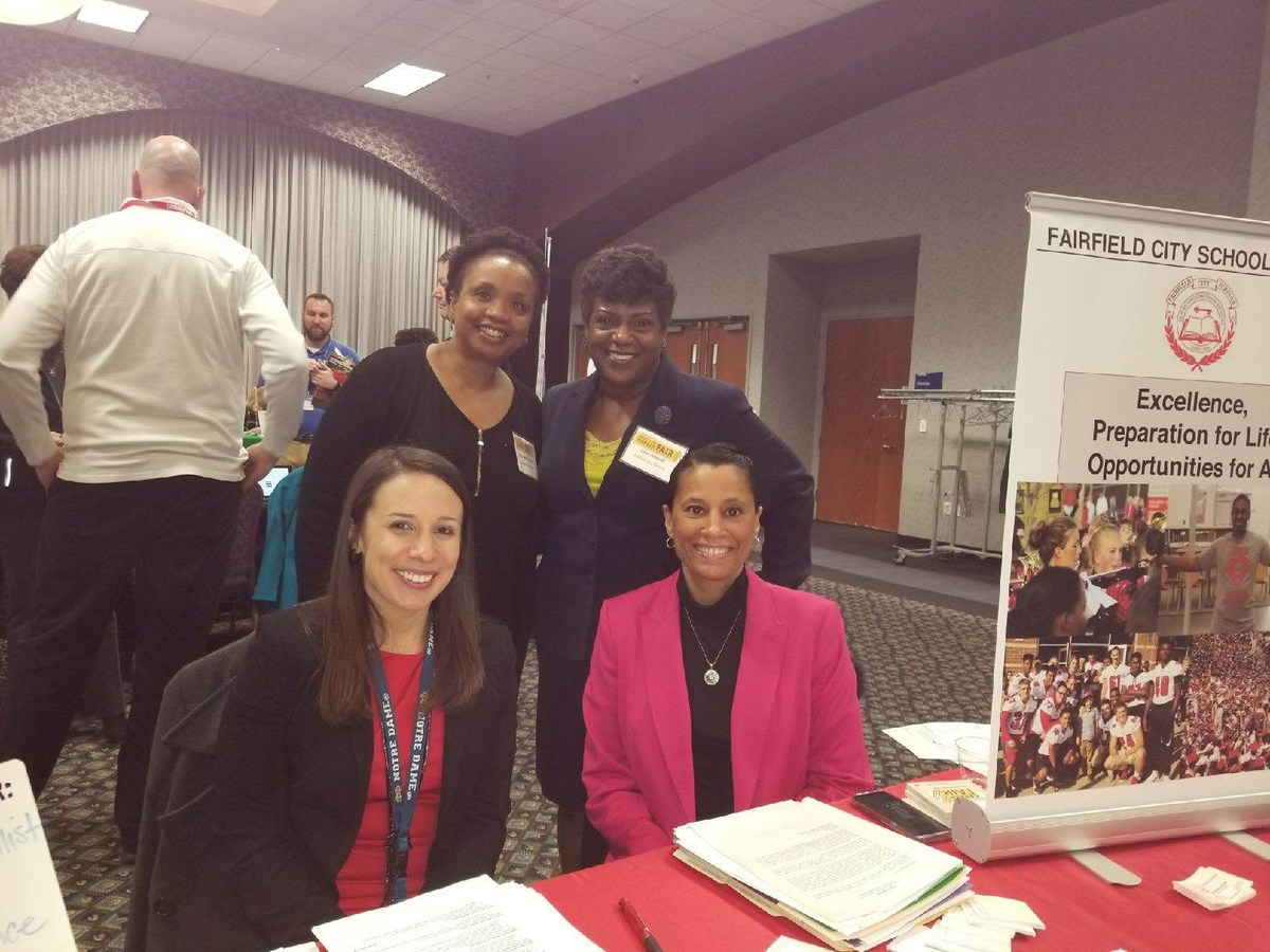 4 members of the Diversity Recruitment and Retention Committee - Denise Hayes, Katie Myers, Gina Gentry-Fletcher, and Dawn Hildreth at their recruiting table at the Xavier University job fair