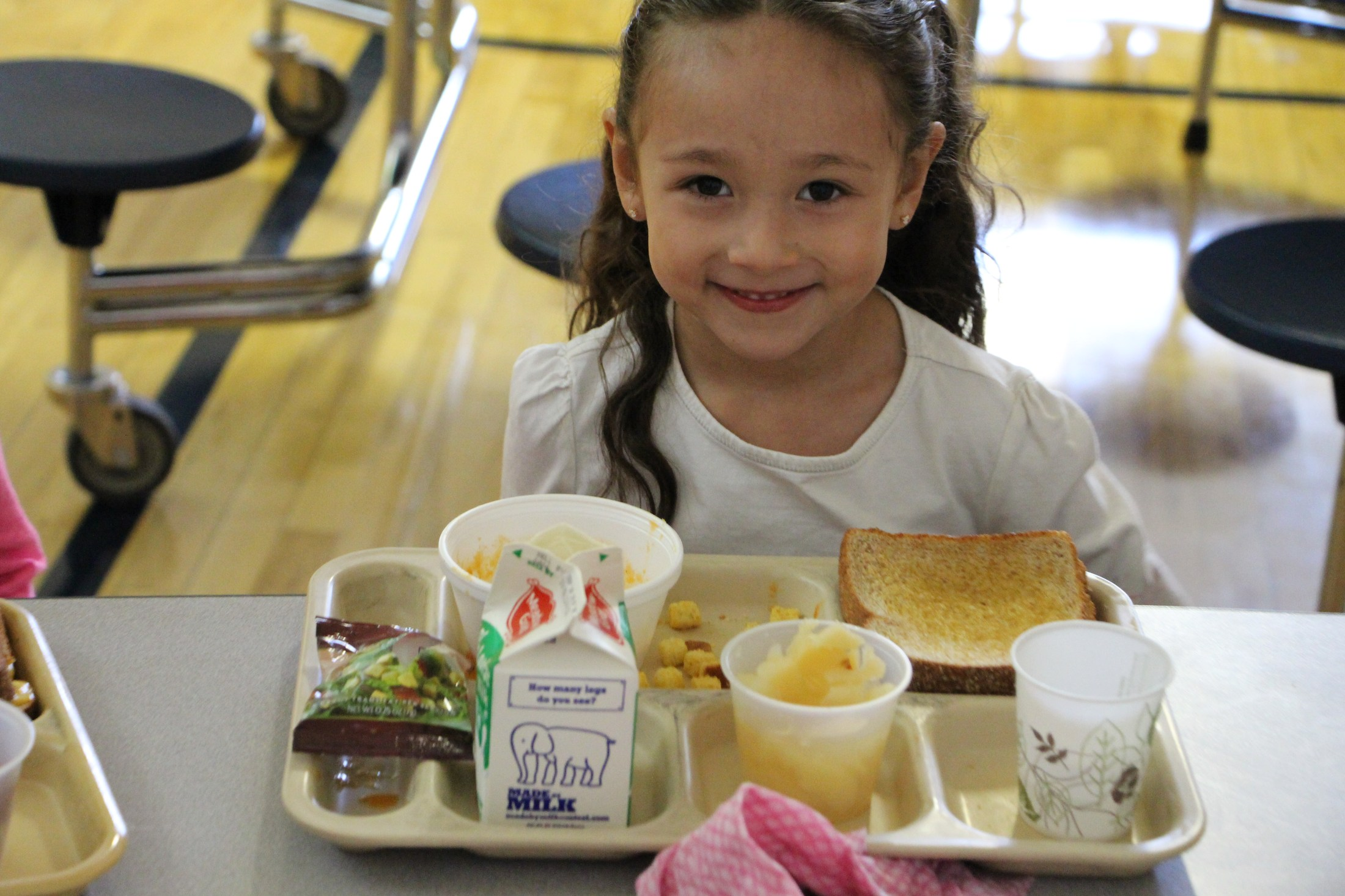 A student enjoys school lunch.