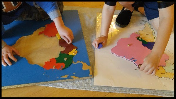 EC kids working with continent map
