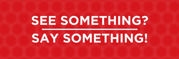 red block with white letters saying see something , say something