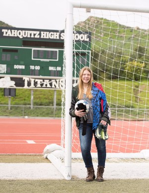 Kaylee Westmoreland in front of a soccer goal.